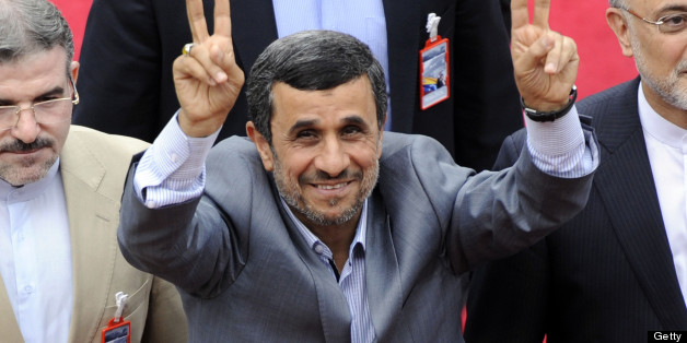 Iran's President Mahmud Ahmadinejad waves as he enters to the National Assembly before  Nicolas Maduro Presidential inauguration in Caracas on April 19, 2013. AFP PHOTO / LEO RAMIREZ        (Photo credit should read LEO RAMIREZ/AFP/Getty Images)
