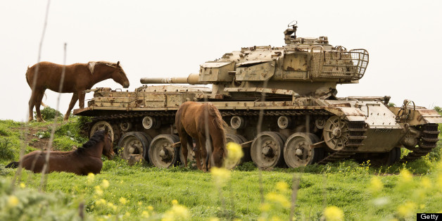 A picture taken on March 8, 2013 shows horses near a former Israeli tank in a field along the border between Syria and Israel, in the Golan Heights. AFP PHOTO / JACK GUEZ        (Photo credit should read JACK GUEZ/AFP/Getty Images)