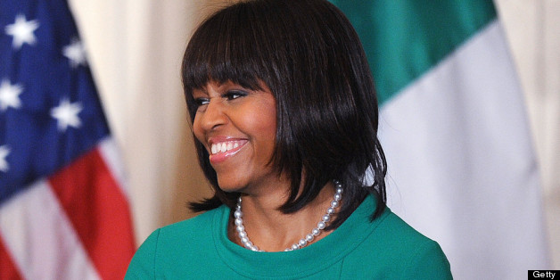 WASHINGTON, DC - MARCH 19:  U.S. First lady Michelle Obama smiles during a reception for Ireland's prime minister in the East Room of the White House on March 19, 2013 in Washington, DC. President Obama met with Irish Prime Minister Enda Kenny prior to the annual St. Patrick's Day lunch hosted at the Capitol. (Photo by Olivier Douliery-Pool/Getty Images)