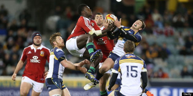 Christian Wade of the Lions competes for the ball in the air with Ian Prior of the Brumbies during the International tour match between the ACT Brumbies in Canberra