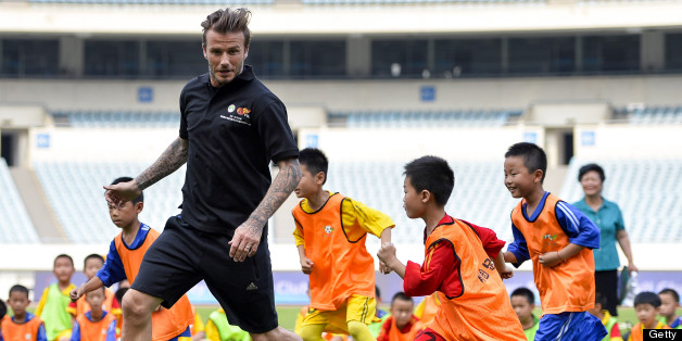 NANJING, CHINA - JUNE 18:  (CHINA OUT) David Beckham plays football with children at at Nanjing Olympic Sports Center on June 18, 2013 in Nanjing, Jiangsu Province of China.  (Photo by ChinaFotoPress/ChinaFotoPress via Getty Images)