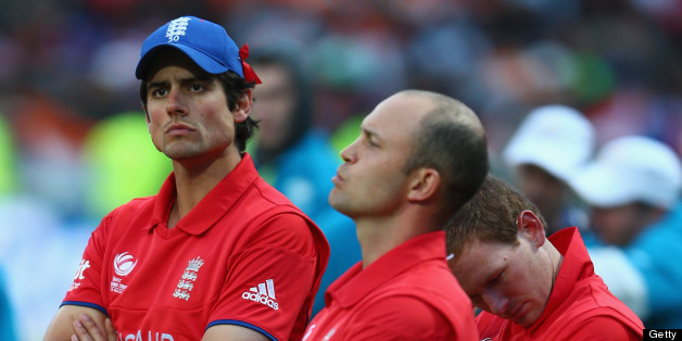 BIRMINGHAM, ENGLAND - JUNE 23:  Alastair Cook (L) captain of England looks on dejectedly during the trophy presentation alongside Jonathan Trott (C), Eoin Morgan (R) after their 5 run defeat to India during the ICC Champions Trophy Final match between England and India at Edgbaston on June 23, 2013 in Birmingham, England.  (Photo by Michael Steele/Getty Images)