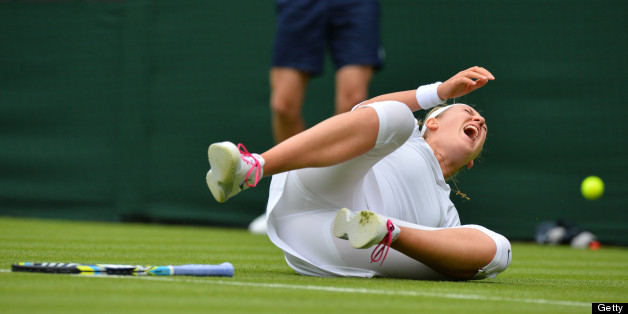 Belarus's Victoria Azarenka falls on court during a point against Portugal's Maria Joao Kohler during their women's first round match on day one of the 2013 Wimbledon Championships tennis tournament at the All England Club in Wimbledon, southwest London, on June 24, 2013. AFP PHOTO / BEN STANSALL -  RESTRICTED TO EDITORIAL USE        (Photo credit should read BEN STANSALL/AFP/Getty Images)