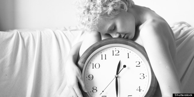 Stock image of woman holding clock