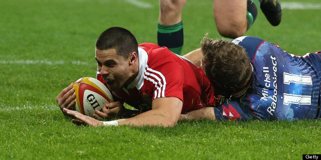 Sean Maitland of the Lions dives over for the Lions second try despite the attention of Lachlan Mitchell