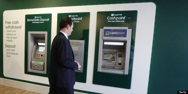 Britain's Chancellor of the Exchequer George Osborne approaches a cash machine at a brank of Lloyds TSB bank in central London on June 19, 2013. AFP PHOTO / POOL / LUKE MACGREGOR        (Photo credit should read LUKE MACGREGOR,LUKE MACGREGOR/AFP/Getty Images)