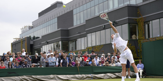 France's Michael Llodra serves against Italy's Andreas Seppi during their second round men's singles match on day four of the 2013 Wimbledon Championships tennis tournament at the All England Club in Wimbledon, southwest London, on June 27, 2013. AFP PHOTO / ADRIAN DENNIS -  RESTRICTED TO EDITORIAL USE        (Photo credit should read ADRIAN DENNIS/AFP/Getty Images)
