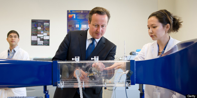 British Prime Minister David Cameron (C) is shown items of engineering equipment in a laboratory at Nazarbayev University ahead of a PM Direct event in Kazakhstan on July 1, 2013.   Cameron flew to Kazakhstan late June 30, as part of a trade mission, on the first ever trip to the country by a serving British prime minister. AFP PHOTO/LEON NEAL/POOL        (Photo credit should read LEON NEAL/AFP/Getty Images)