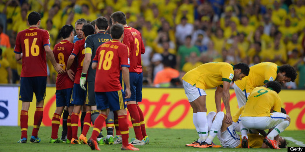Gerard Pique of Spain (3) is sent off after a foul on Neymar of Brazil (grounded right) the FIFA Confederations Cup Brazil 2013 Final match between Brazil and Spain at Maracana