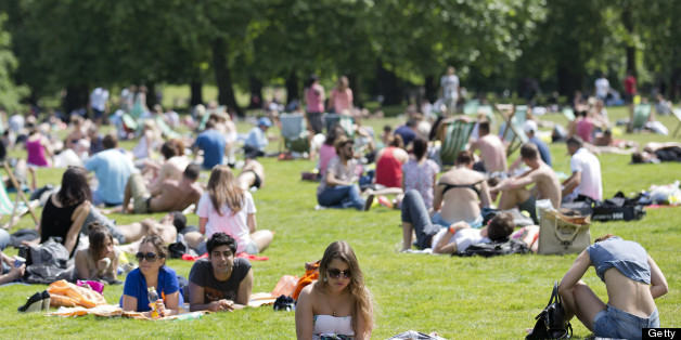 People sunbathe in the summer heat in a park in central London on June 30, 2013. AFP PHOTO / JUSTIN TALLIS        (Photo credit should read JUSTIN TALLIS/AFP/Getty Images)