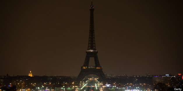 The Eiffel Tower is seen before plunging into darkness at 8:30 p.m. (local time) as part of the Earth Hour switch-off on March 23, 2013, in Paris. (BERTRAND LANGLOIS/AFP/Getty Images)