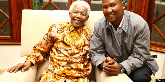Chief Mandla Mandela with his grandfather Nelson Mandela as they share a joke on March 27, 2010 in Johannesburg, South Africa.