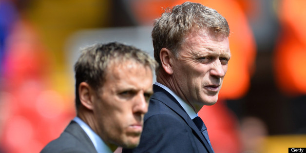 Everton's English defender Phil Neville (L) stands with manager David Moyes before the start of the English Premier League football match between Liverpool and Everton at the Anfield stadium in Liverpool, northwest England, on May 5, 2013. AFP PHOTO / PAUL ELLIS  RESTRICTED TO EDITORIAL USE. No use with unauthorized audio, video, data, fixture lists, club/league logos or ?live? services. Online in-match use limited to 45 images, no video emulation. No use in betting, games or single club/league/