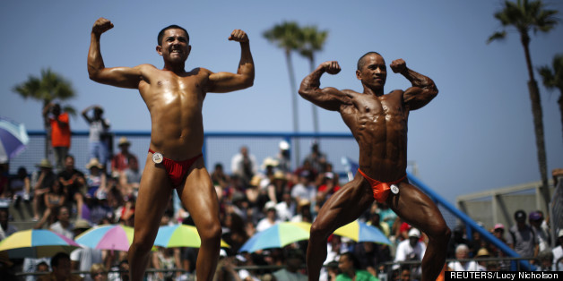 Men and women compete in the Muscle Beach Independence Day bodybuilding contest on Venice Beach in Los Angeles, California, July 4, 2013. (Credit: REUTERS/Lucy Nicholson)