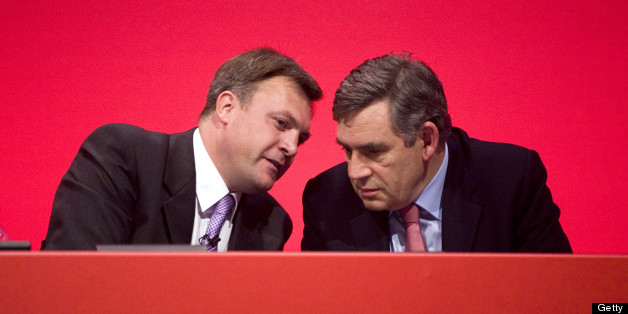 UNITED KINGDOM - SEPTEMBER 30:  Ed Balls, U.K. education secretary, left, speaks with Gordon Brown, U.K. prime minister, during the Labour party conference in Brighton, U.K., on Wednesday, Sept. 30, 2009. Brown's attack on bankers and the rich won praise from traditional supporters of Britain's ruling Labour Party and risked alienating business leaders who helped his party win the last three elections.  (Photo by Chris Ratcliffe/Bloomberg via Getty Images)