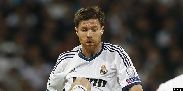 MADRID, SPAIN - APRIL 30: Xabi Alonso of Real Madrid controls the ball during the UEFA Champions League Semi Final second leg match between Real Madrid and Borussia Dortmund at Estadio Santiago Bernabeu on April 30, 2013 in Madrid, Spain. (Photo by Helios de la Rubia/Real Madrid via Getty Images)