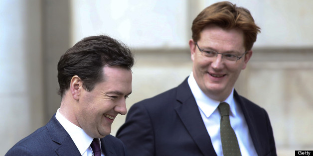 George Osborne, U.K. chancellor of the exchequer, left, reacts with Danny Alexander, U.K. chief secretary to the treasury, as they leave the HM Treasury building for the Houses of Parliament in London, U.K., on Wednesday, Dec. 5, 2012. Osborne faces the prospect of breaching his self-imposed budget rules as an economy struggling to escape recession drives debt higher and erodes his political capital. Photographer: Chris Ratcliffe/Bloomberg via Getty Images