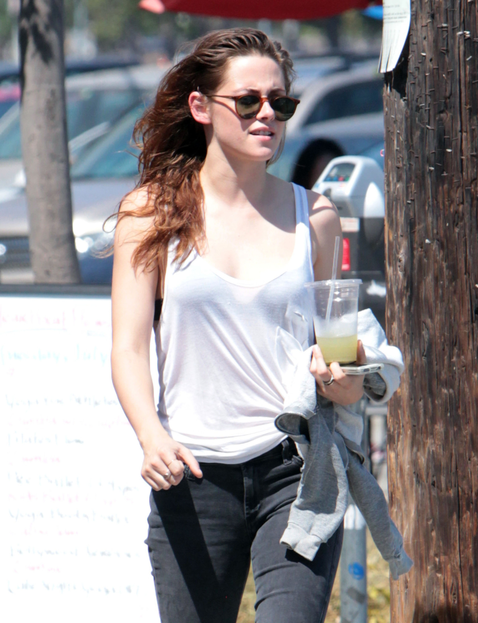 kristen stewart flashes bra through seethrough shirt