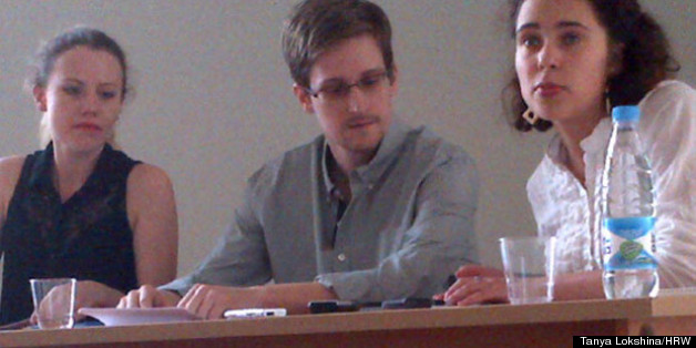 The first picture of Edward Snowden since he fled Hong Kong, with WikiLeaks lawyer Sarah Harrison on his right, and a translator on his left