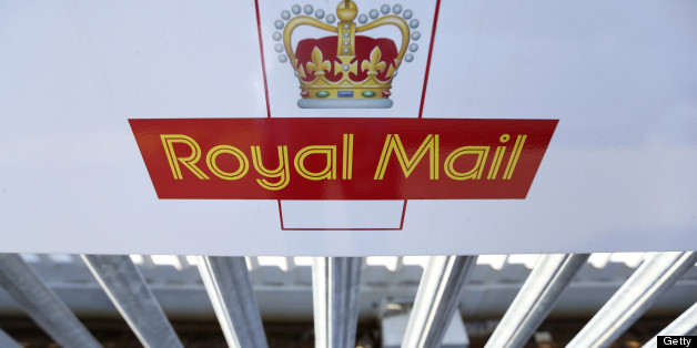 A logo sits on a sign outside Royal Mail Group Ltd.'s postal sorting office in Romford, U.K., on Wednesday, July 10, 2013. The U.K. government will sell a majority stake in Royal Mail Group Ltd., the 360-year-old state postal service, through an initial public offering before the end of March, Business Secretary Vince Cable said. Photographer: Chris Ratcliffe/Bloomberg via Getty Images