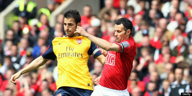 MANCHESTER, ENGLAND - MAY 16: Ryan Giggs of Manchester United clashes with Cesc Fabregas of Arsenal during the Barclays Premier League match between Manchester United and Arsenal at Old Trafford on May 16 2009, in Manchester, England. (Photo by Matthew Peters/Manchester United via Getty Images)