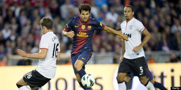 Cesc Fabregas (C) of Barcelona vies for the ball with Michael Carrick (L) and Rio Ferdinand (R) of Manchester during the friendly football match between Barcelona FC and Manchester United at Ullevi Stadium in Gothenburg on August 8, 2012. AFP PHOTO / SCANPIX-SWEDEN / BJORN LARSSON ROSVALL ***SWEDEN OUT***        (Photo credit should read BJORN LARSSON ROSVALL/AFP/GettyImages)