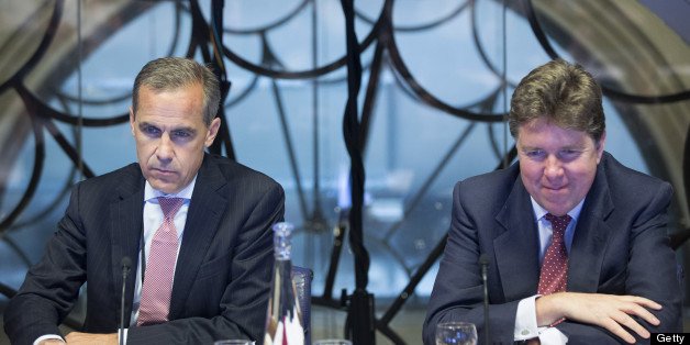 Mark Carney, governor of the Bank of England, left, and Paul Tucker, outgoing deputy governor at the Bank of England, listen during a monetary policy committee (MPC) briefing meeting inside the central bank's headquarters in London, U.K., on Monday, July 1, 2013. Carney takes the Bank of England helm today facing a struggle to make his policies count more than those of his U.S. counterpart for U.K. government debt. Photographer: Jason Alden/Pool/Bloomberg via Getty Images