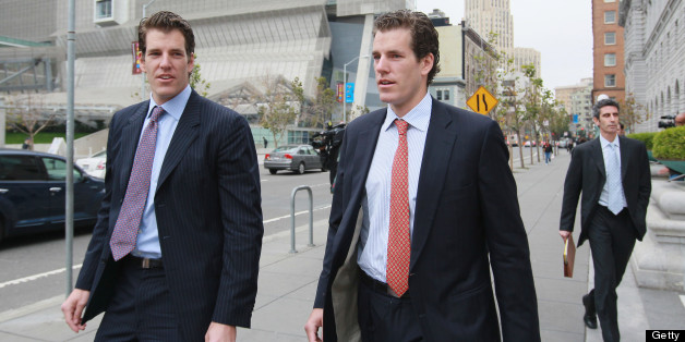 SAN FRANCISCO - JANUARY 11:  Cameron (C) and Tyler Winklevoss (L) leave the U.S. Court of Appeals on January 11, 2011 in San Francisco, California. Twin brothers and former Harvard University classmates Cameron and Tyler Winklevoss are requesting that a three-judge panel of the U.S. Court of Appeals in San Francisco to void a 2008 agreement to pay the twins $65 million citing that Facebook did not give an accurate valuation of its shares before agreeing to pay the settlement.  (Photo by Justin S
