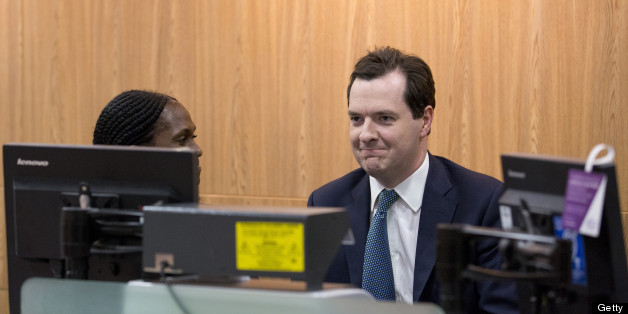 Britain's Chancellor of the Exchequer George Osborne (R) is shown a money counting machine by a member of staff in a branch of Lloyds bank in Central London on June 19, 2013. AFP PHOTO / JUSTIN TALLIS        (Photo credit should read JUSTIN TALLIS/AFP/Getty Images)