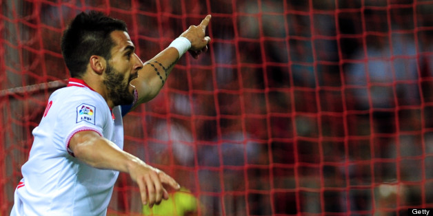 Sevilla's forward Alvaro Negredo reacts during the Spanish league football match Sevilla FC vs Atletico de Madrid at the Ramon Sanchez Pizjuan in Sevilla on April 21, 2013. Atletico de Madrid won the match 1-0. AFP PHOTO / CRISTINA QUICLER        (Photo credit should read CRISTINA QUICLER/AFP/Getty Images)
