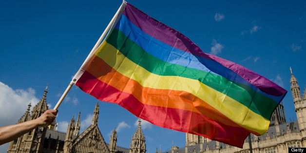 A protestor holds a rainbow flag outside the Houses of Parliament in central London on June 3, 2013, as protestors gather in support of same-sex marriage.  A 'wrecking amendment' aimed at derailing the government's same-sex marriage bill, which was passed in the Commons despite the opposition of 133 Tory MPs, is being debated in the House of Lords.  AFP PHOTO/Leon Neal        (Photo credit should read LEON NEAL/AFP/Getty Images)