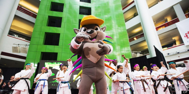 Karate athletes help unveil Pachi the porcupine as the new mascot for the Toronto 2015 Pan Am/Parapan Am Games in Toronto on Wednesday, July 17, 2013. (THE CANADIAN PRESS/Michelle Siu)