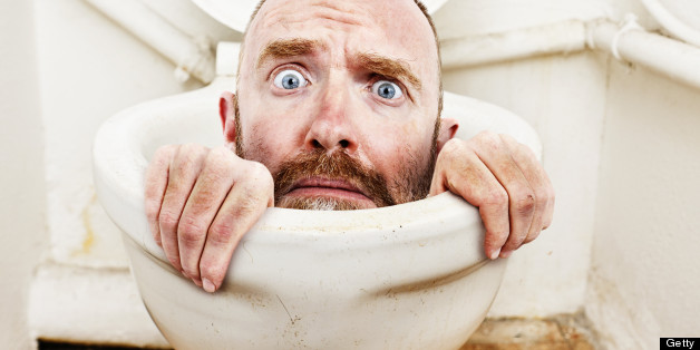 A desperate-looking man tries to claw his way out of a toilet bowl in this bizarre and humorous montage, symbolic of all kinds of problems.