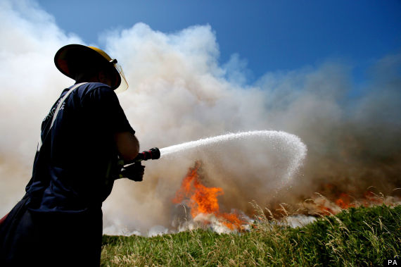 a firefighter battling a gorse blaze on howth head