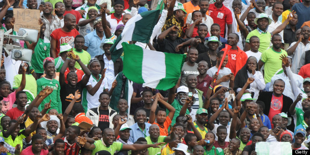 Nigerian players celebrate with the crowd after their 2014 African Nations Championship (CHAN) qualification football match against Ivory Coast on July 6, 2013 in Kaduna. Nigeria defeated Ivory Coast 4 - 1. AFP PHOTO/PIUS UTOMI EKPEI        (Photo credit should read PIUS UTOMI EKPEI/AFP/Getty Images)
