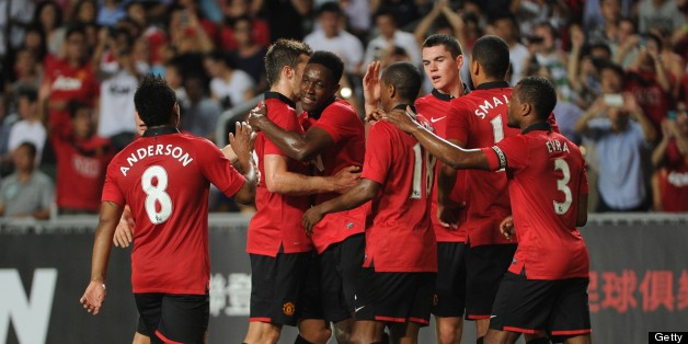 Manchester United players celebrate a goal against Kitchee during their football friendly match at Hong Kong stadium on July 29, 2013. AFP PHOTO / Dale de la Rey        (Photo credit should read DALE de la REY/AFP/Getty Images)