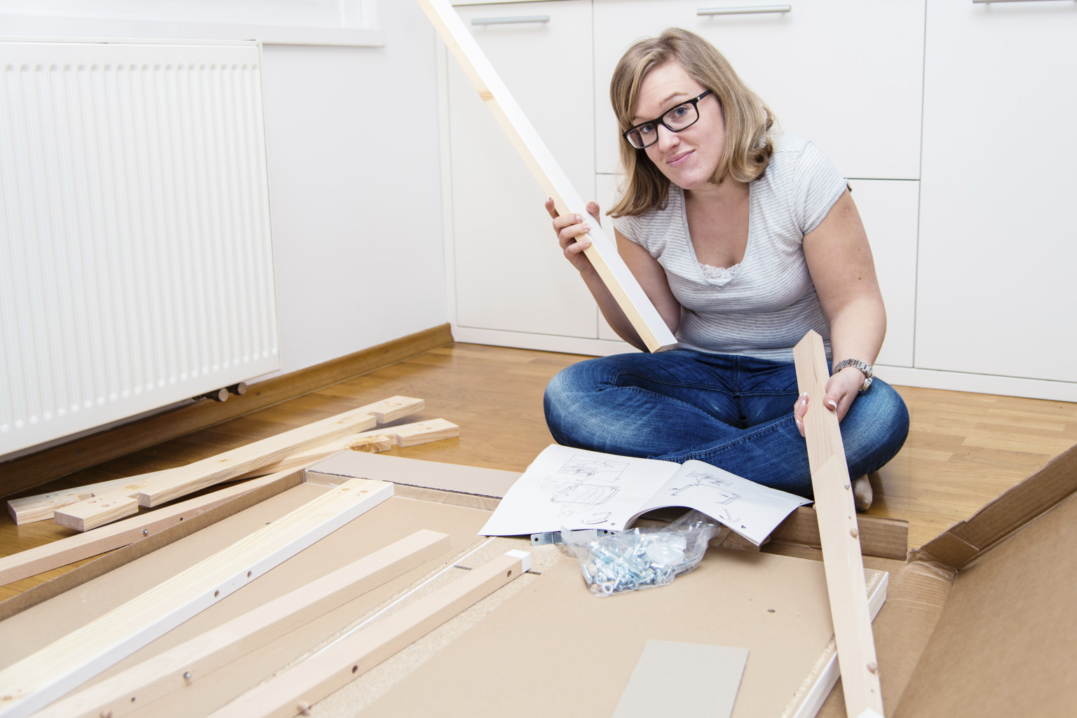The 7 emotional stages of ikea furniture assembly huffpost for Ikea flat pack garden