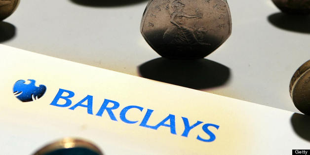 A Barclays bank leaflet is pictured with coins in London, on August 7, 2008. British bank Barclays said Thursday that net profit slumped 35 percent in the first half, hit by write-downs of 2.1 billion dollars (1.4 billion euros) from the US subprime housing and credit crises. Barclays, the third-biggest British bank by market value, said in its results statement that profit after tax had tumbled to 1.72 billion pounds (2.17 billion euros, 3.35 billion dollars) in the first half compared with the