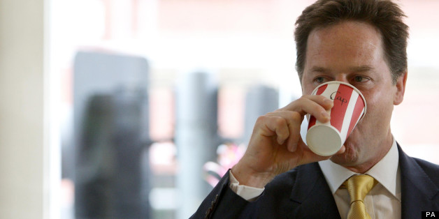 Deputy Prime Minister Nick Clegg drinks a coffee at the Olive Delicatessen in Manchester city centre.