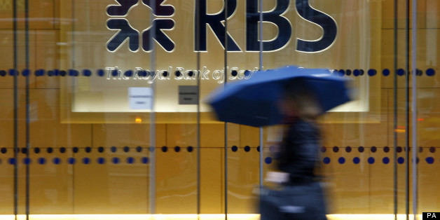 File photo dated 03/12/09 of a woman walking past the headquarters of the Royal Bank of Scotland in the City of London as the bank is reportedly poised to name insider Ross McEwan, its head of retail banking, as successor to chief executive Stephen Hester.