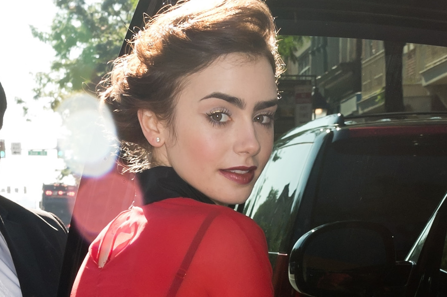 Lily Collins' Boots Are A Stylish Nod To 'Pretty Woman' (PHOTOS)