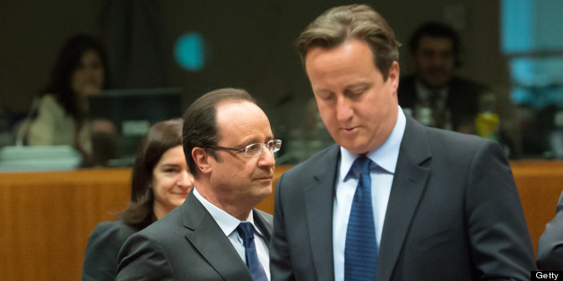 French President  Francois Hollande (L) and British Prime Minister David Cameron arrive for a roundtable meeting at the EU headquarters on June 7, 2013 in Brussels, during European Union leaders summit. European Commission President Jose Manuel Barroso on Thursday announced a political deal on the EU's hotly contested 2014-2020 trillion-euro budget, hours before an EU summit mulls how to get millions of jobless youths back into the workplace.  AFP PHOTO / BERTRAND LANGLOIS        (Photo credit s