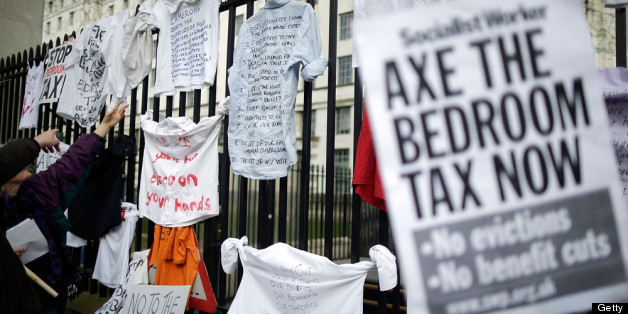 LONDON, ENGLAND - MARCH 30:  Protestors hang signs on the gates as they demonstrate against the proposed 'bedroom tax' gather in Trafalgar Square before marching to Downing Street on March 30, 2013 in London, England. Welfare groups are protesting the government's plans to cut benefits where families have surpassed the number of rooms they require. (Photo by Matthew Lloyd/Getty Images)