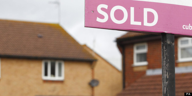 File photo dated 02/10/2012 of a general view of an estate agent's 'Sold' sign outside a property, as house prices increased at their fastest rate in three years in July in further signs of a market revival, Nationwide has reported.