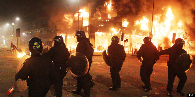 Riot police during the first night of the riots, in Tottenham, London
