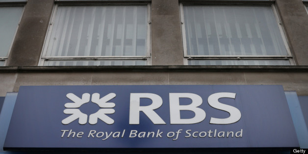 LONDON, ENGLAND - APRIL 03:  A sign hangs over the entrance to a branch of The Royal Bank of Scotland on April 3, 2013 in London, England. Investors have launched a compensation claim against The Royal Bank of Scotland claiming that the bank misled shareholders about the state of it's books before it collapsed in 2008.  (Photo by Peter Macdiarmid/Getty Images)