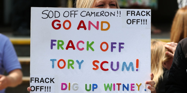 Anti-fracking protesters outside as Prime Minister, David Cameron visited the Wigan Youth Zone boys and girls club.