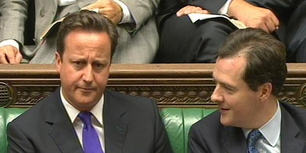 Prime Minister David Cameron listens to Chancellor George Osborne