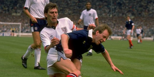 21 May 1988:  Bryan Robson of England tackles Paul Simpson of Scotland during the Rous Cup match at Wembley Stadium in London. England won the match 1-0.  \ Mandatory Credit: David  Cannon/Allsport