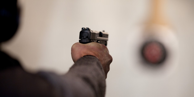 A student fires a semi-automatic handgun on the firing range at the end of a basic firearms safety class (file photo)